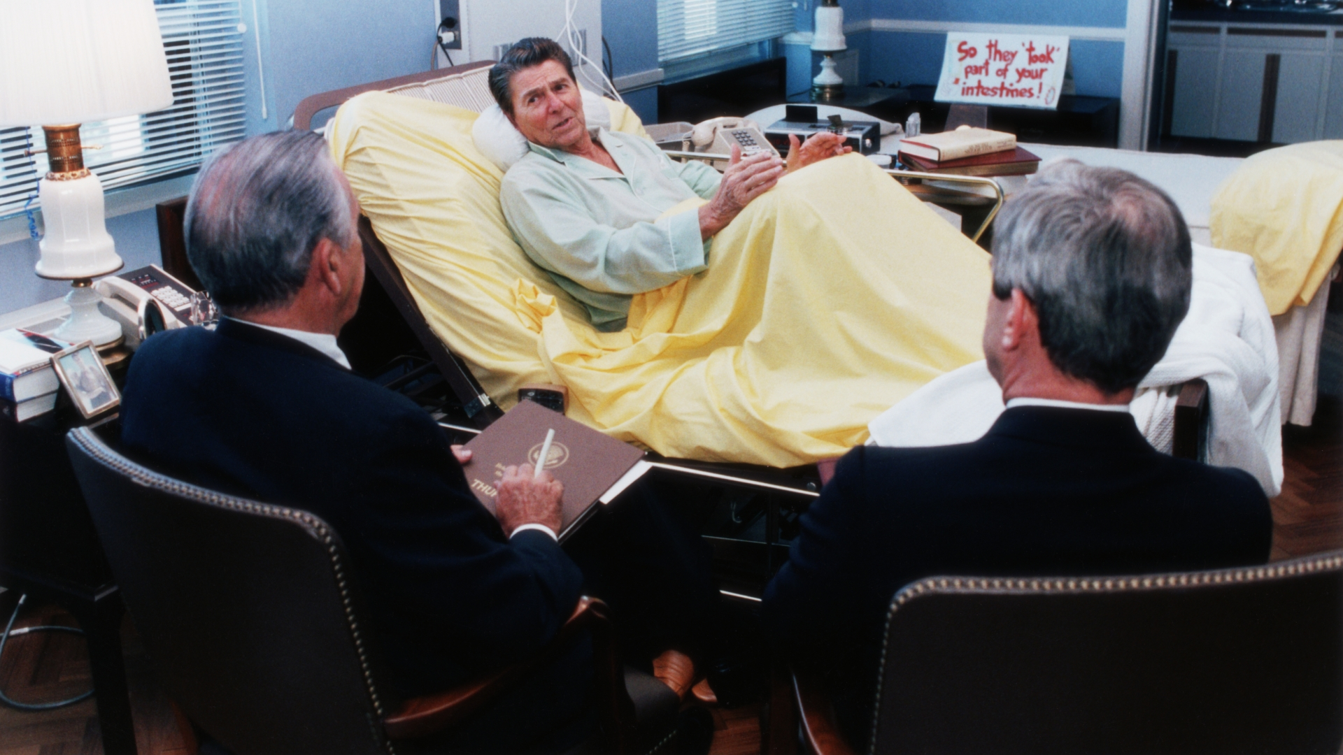 President Ronald Reagan holding a meeting with advisers while in the hospital for colon cancer surgery, 1985. (Credit: Corbis via Getty Images)