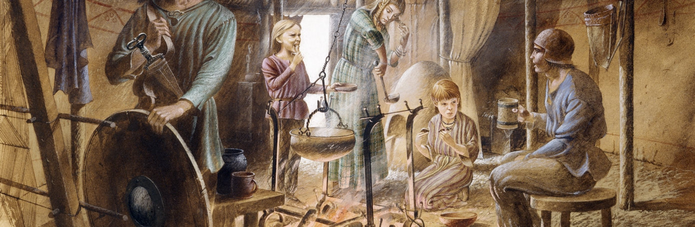 Inside a hut showing family life in the Iron Age. (Credit: English Heritage/Heritage Images/Getty Images)