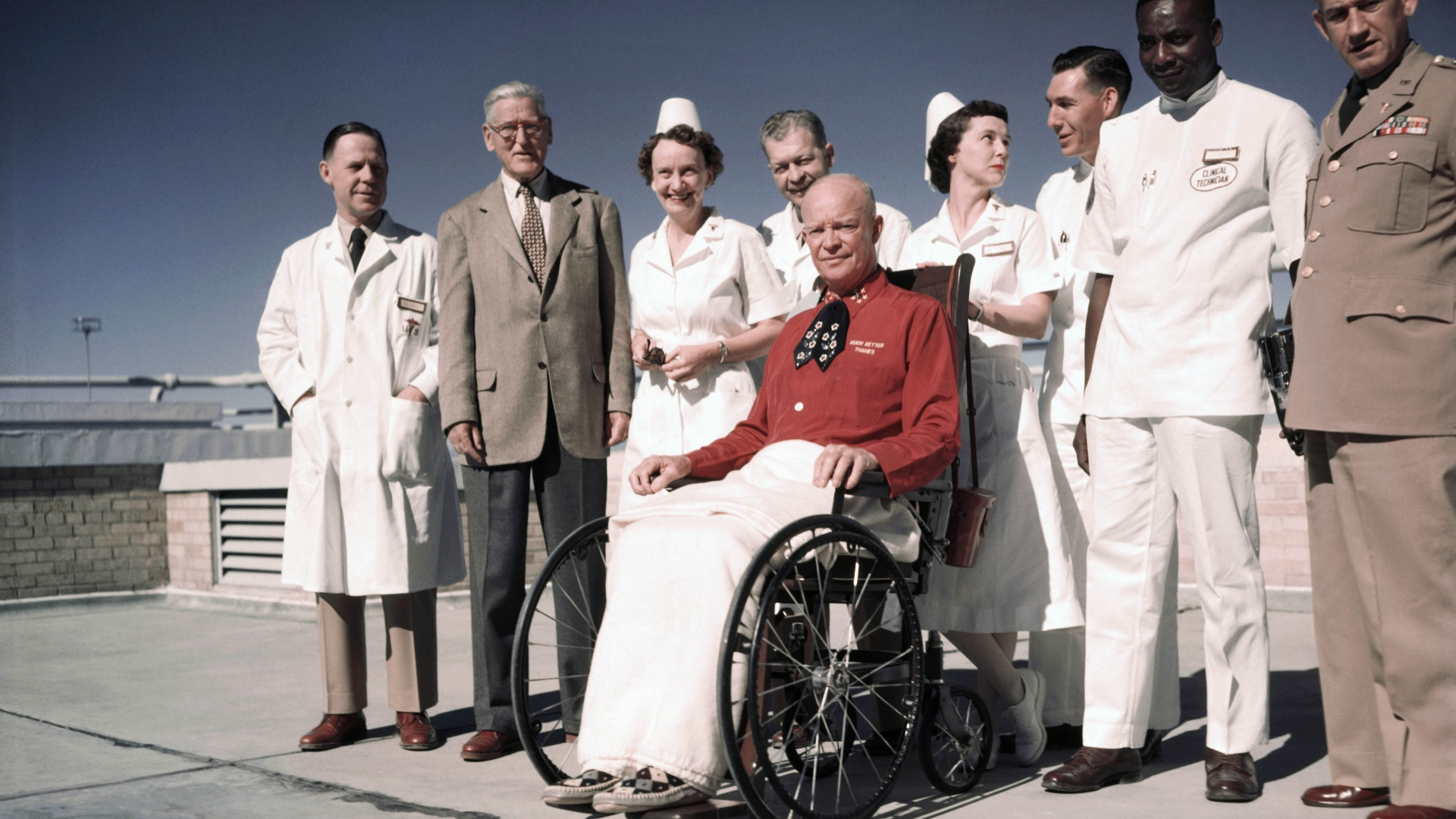 """President Eisenhower posing for first pictures since his heart attack. His red shirt reads """"Much Better Thanks"""" over the pocket. (Credit: Bettmann Archive/Getty Images)"""