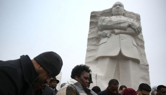 People gathering in front of the Martin Luther King Jr. memorial in Washington, DC on his birthday, a nationally observed holiday. (Credit: Joe Raedle/Getty Images)