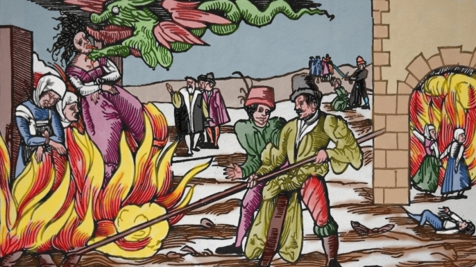 A colorized illustration from a newsletter about the public burning of 3 witches at Derneburg, Germany, in 1555. (Credit: