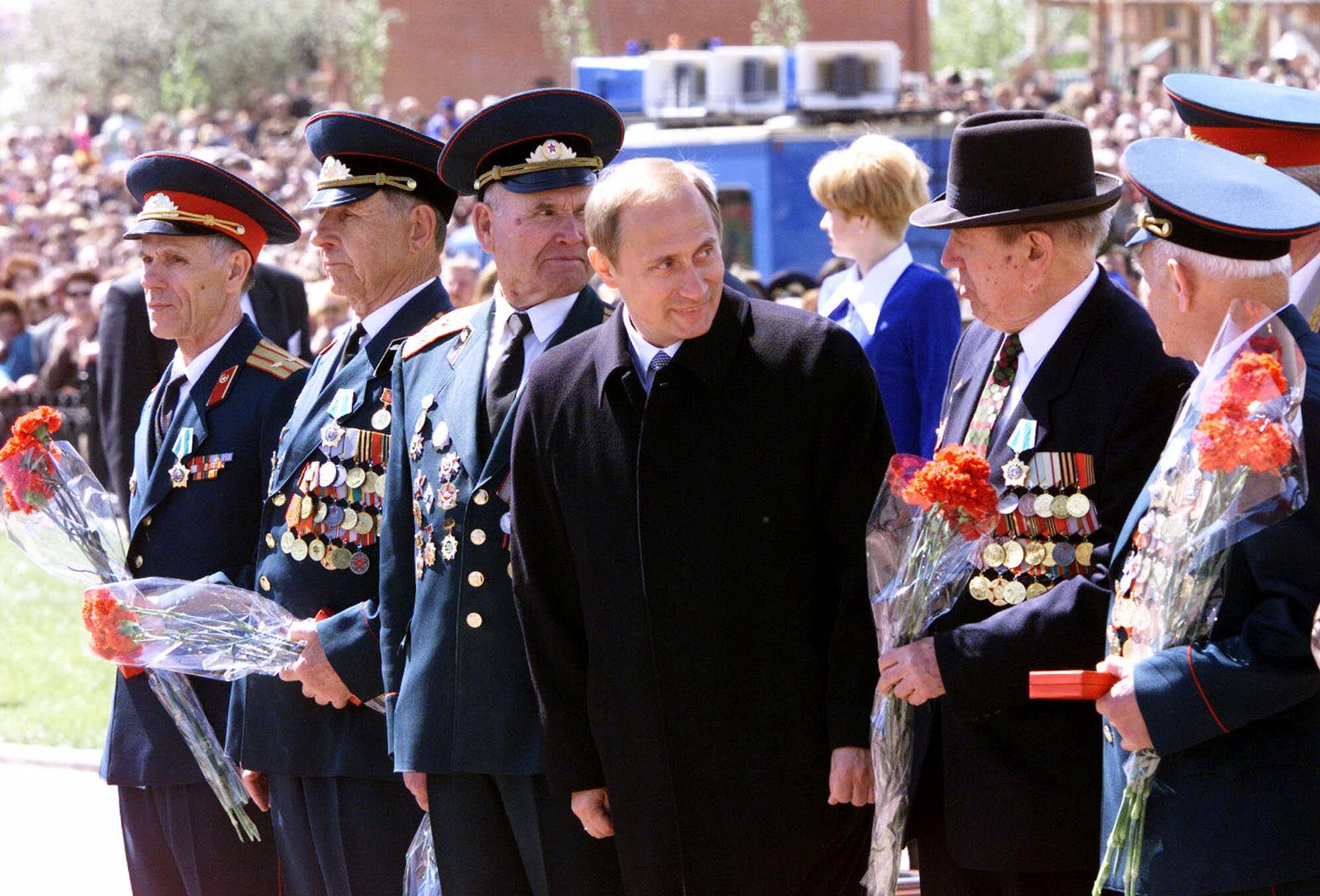 Vladimir Putin in May 2000 with World War II veterans in Kursk, Russia, site of history's biggest tank battle, when Soviet forces defeated a major Nazi German offensive in 1943. Putin invoked WWII victories as a way to restore Russian pride after the Soviet collapse. (Credit: AP Photo)
