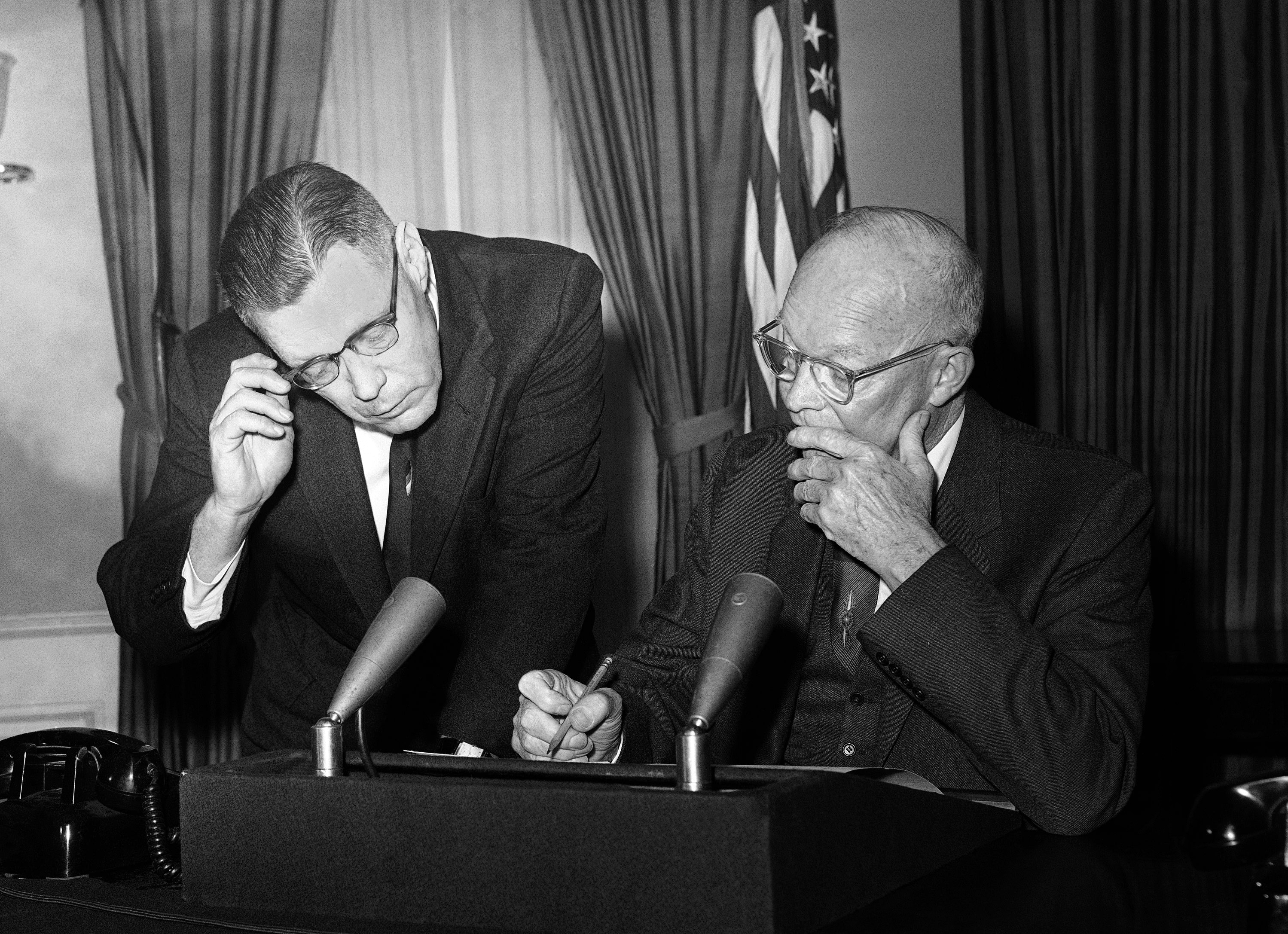President Dwight Eisenhower and his press secretary, James Hagerty, make a final check of the chief executive''s farewell address, 1961. (Credit: Bill Allen/AP Photo)