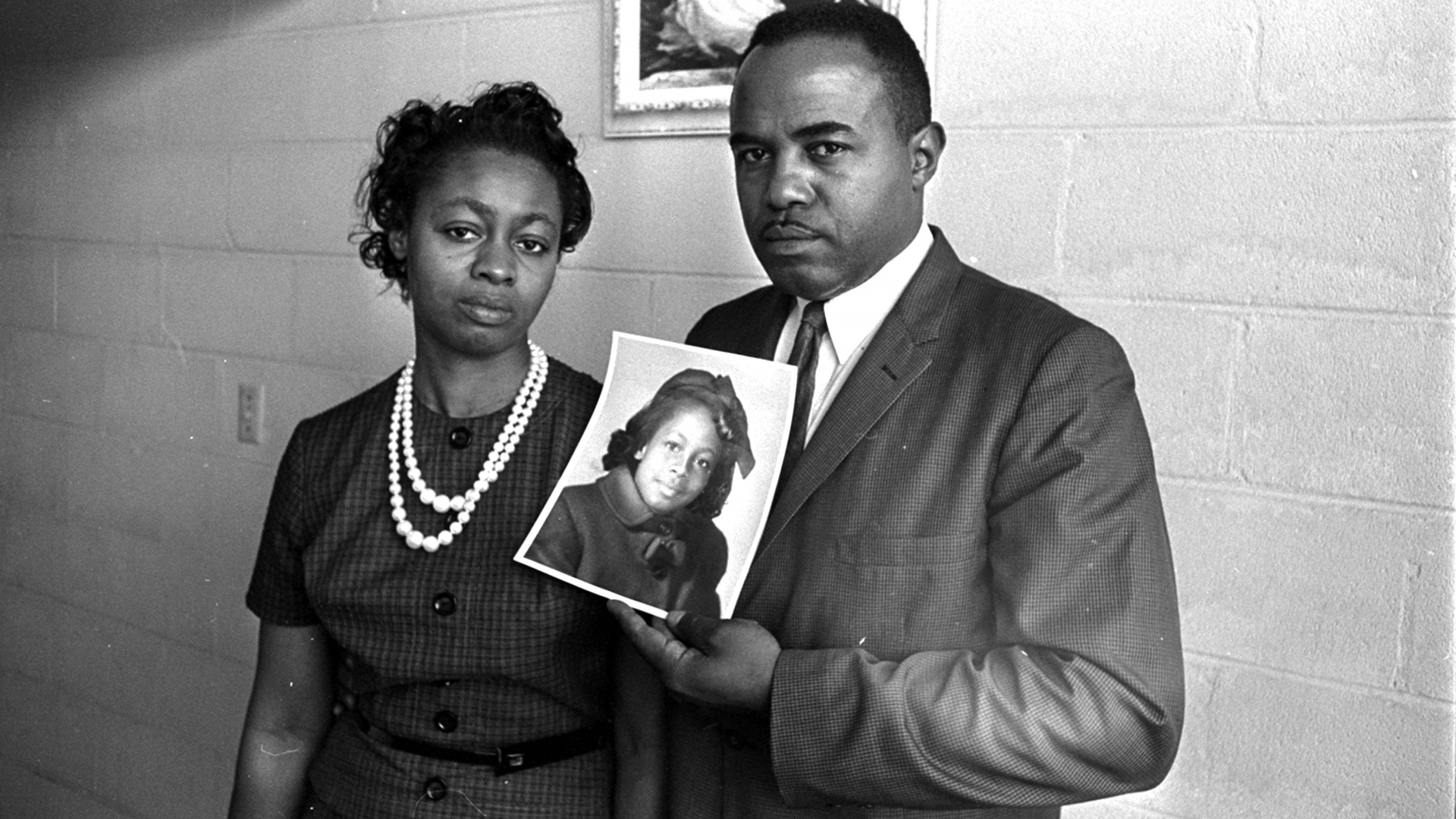 Mr. and Mrs. Chris McNair with a picture of their daughter, Denise, 11, who was one of the four girls who died in the 16th Street Church bombing in Birmingham, 1963. (Credit: AP Photo)