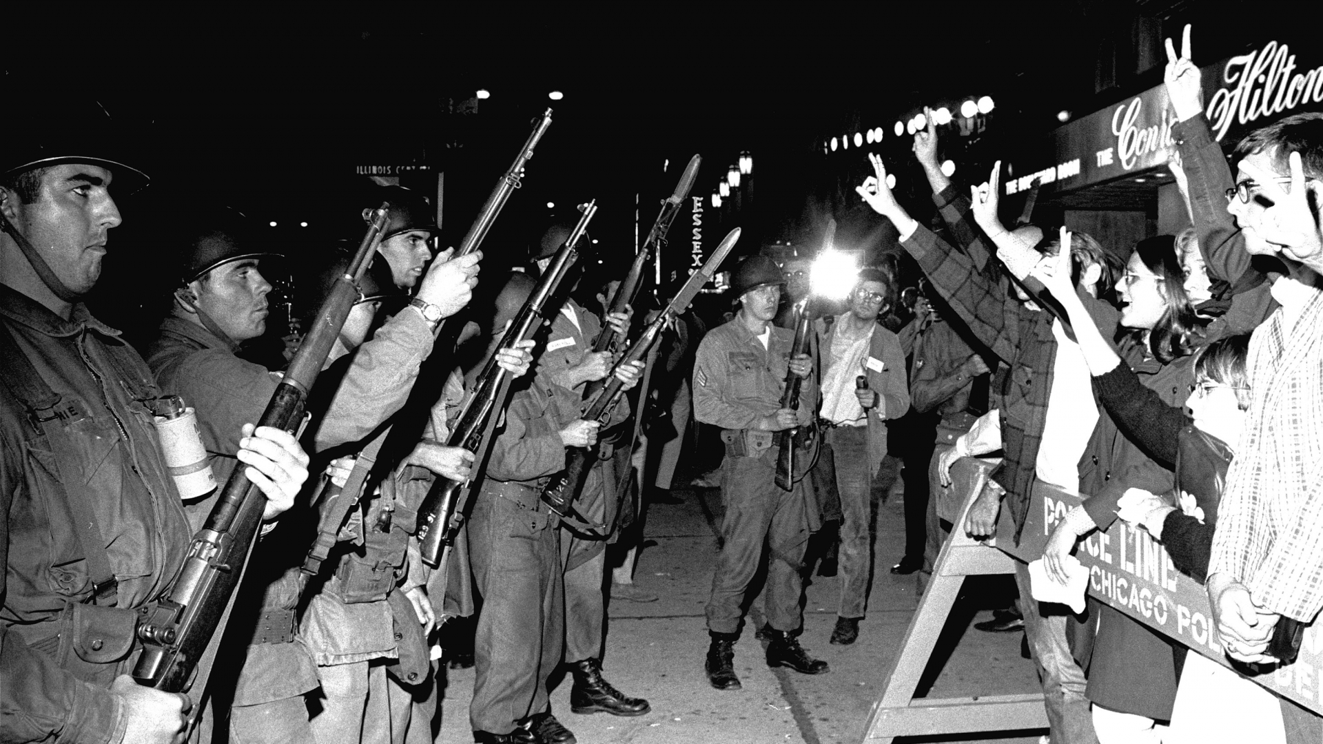 Peace demonstrators taunt Illinois National Guardsmen outside the Democratic National Convention headquarters hotel, on August 29, 1968. (Credit: AP Photo)