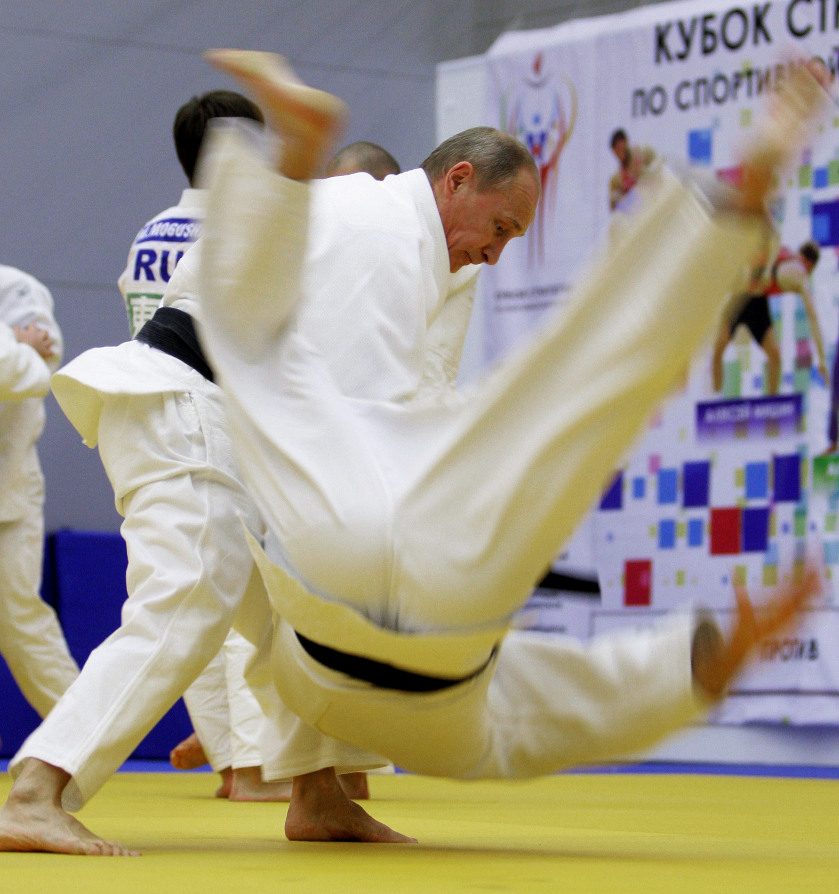 Vladimir Putin taking part in a judo training session in St. Petersburg, 2010. (Credit: Alexey Druzhinin/AFP/Getty Images)