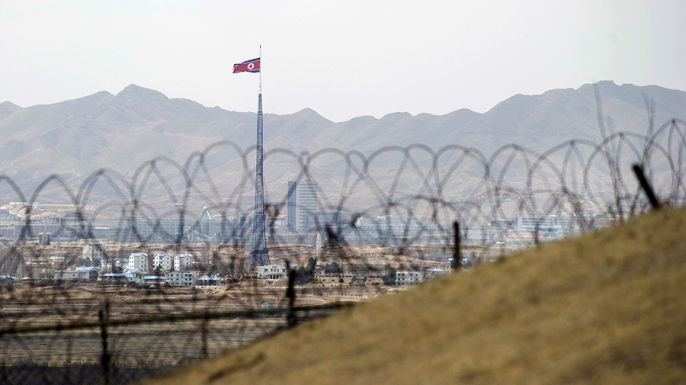 North Korea's propaganda village of Gijeongdong as seen through barbed wire from the the Joint Security Area of the Demilitarized Zone on the border between North and South Korea. (Credit: Saul Loeb/AFP/Getty Images)