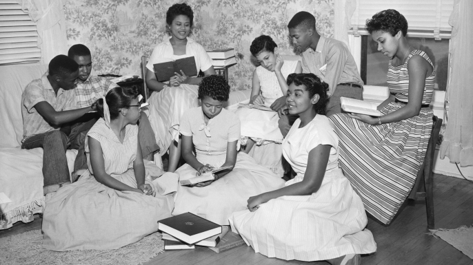 The Little Rock Nine forming a study group after being prevented from entering Little Rock's Central High School. (Credit: Bettmann Archive/Getty Images)