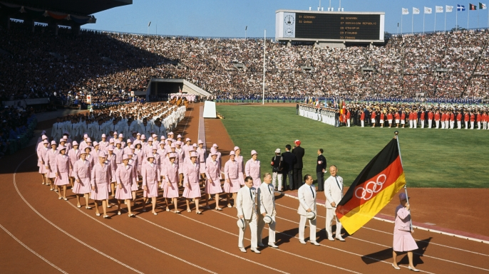 The German Team marching under a unified flag during the 1964 opening ceremony. (Credit: Bettmann Archive/Getty Images)