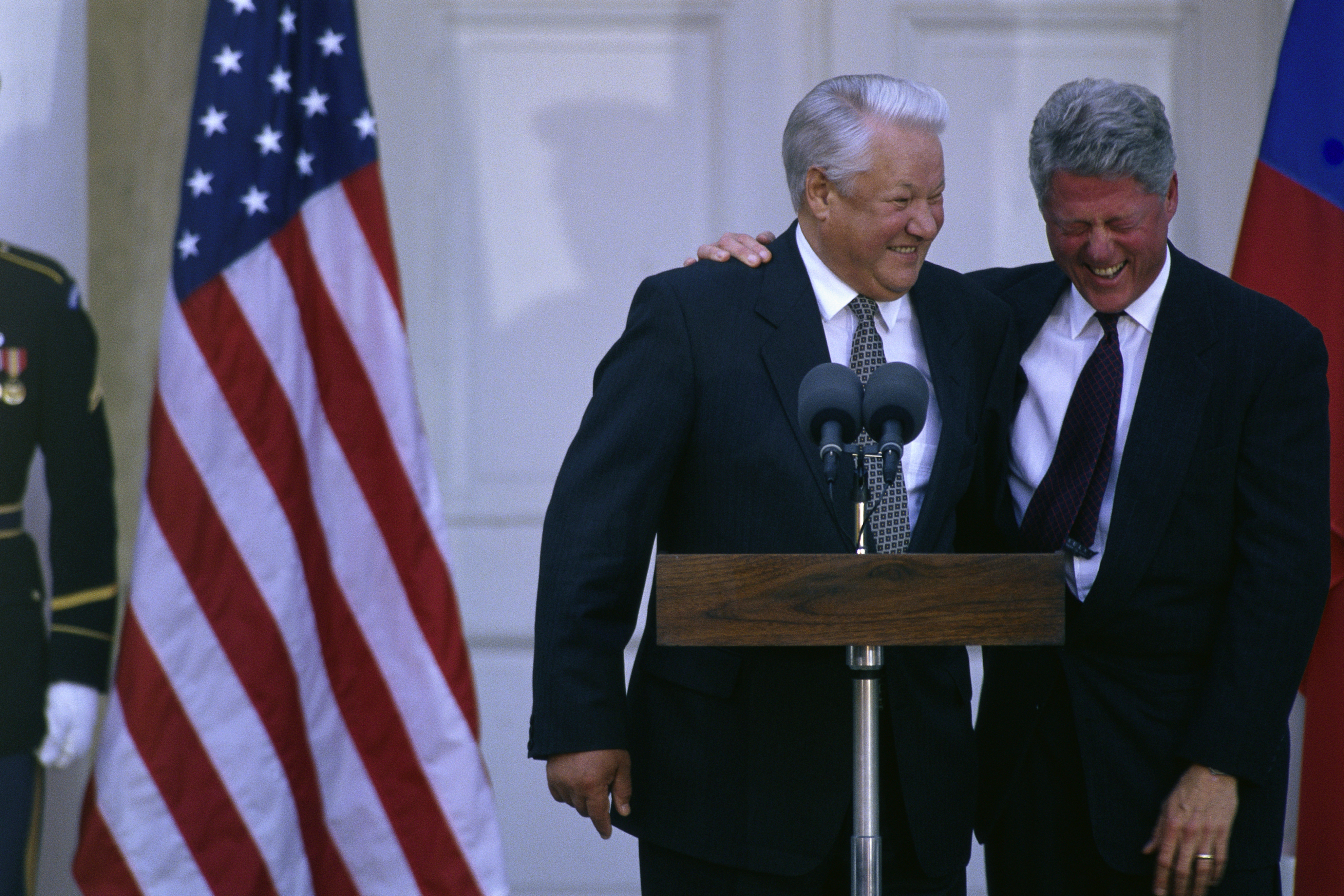American President Bill Clinton laughs at Boris Yeltsin's jokes during a joint news conference in Hyde Park, New York. Putin was determined to regain international respect he felt Yeltsin had lost. (Credit: Wally McNamee/Corbis/Getty Images)