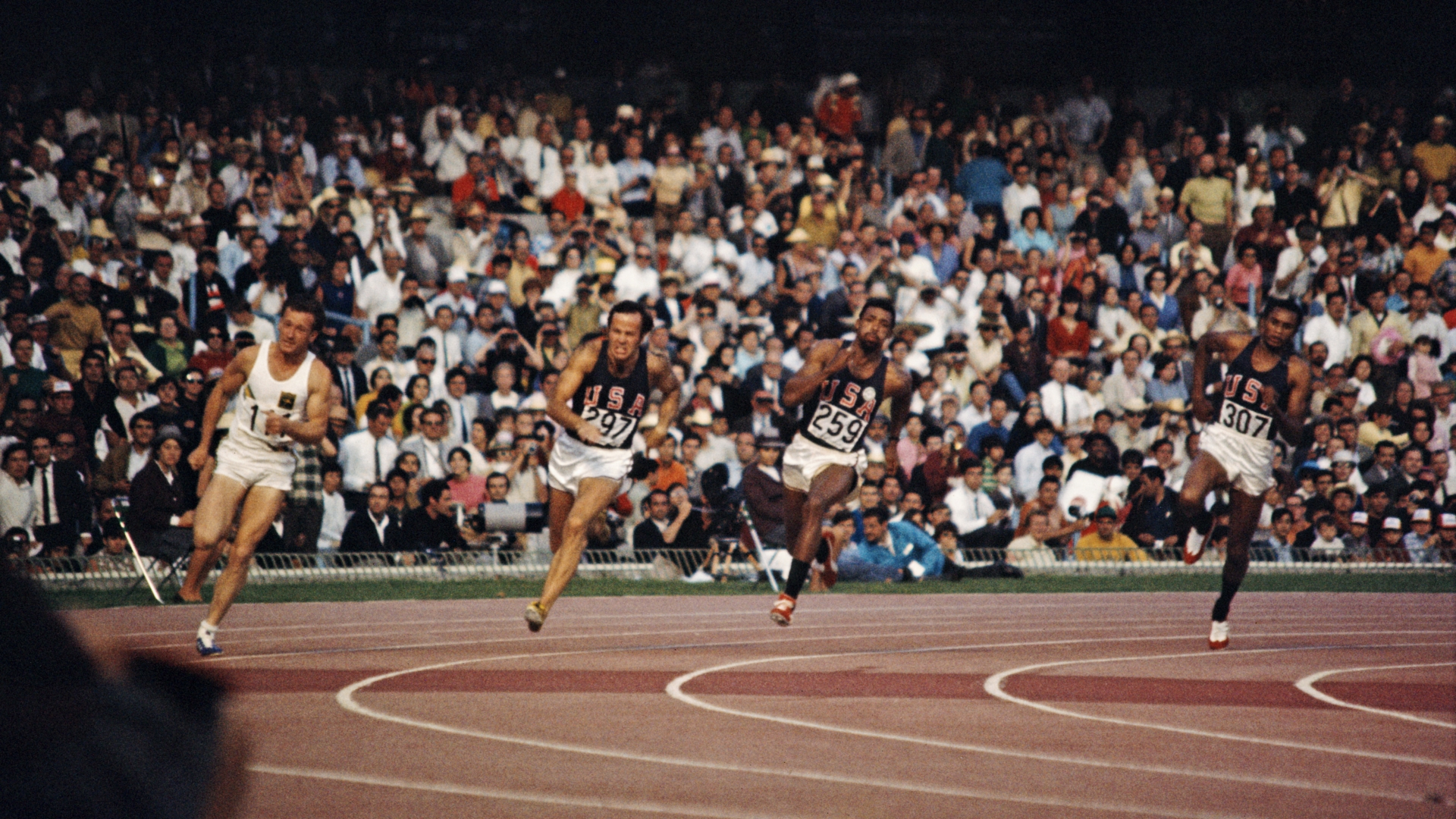 The final of the Men's 200 meter event at the 1968 Summer Games. From left to right: Peter Norman of Australia, and Larry Questad, John Carlos and Tommie Smith of the United States. (Credit: Rolls Press/Popperfoto/Getty Images)