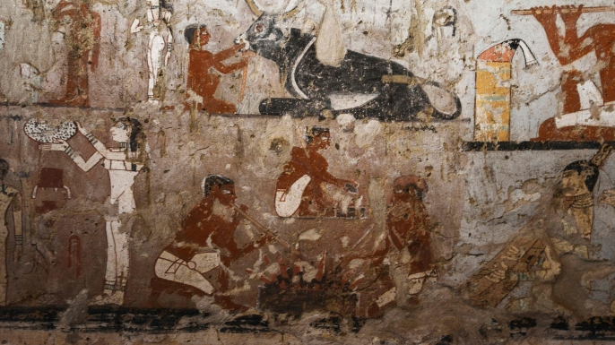 Well-preserved and rare wall paintings inside the tomb of an Old Kingdom priestess on the Giza plateau on the outskirts of Cairo, that was unveiled on February 3, 2018, after being discovered during excavation work in Giza's western cemetery by a team of Egyptian archaeologists. (Credit: Mohamed El-Shahed/AFP/Getty Images)