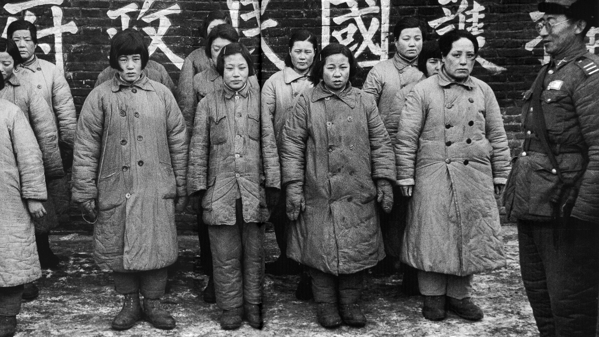 "A Nationalist officer guarding women prisoners said to be ""comfort girls"" used by the Communists, 1948. (Credit: Jack Birns/The LIFE Picture Collection/Getty Images)"