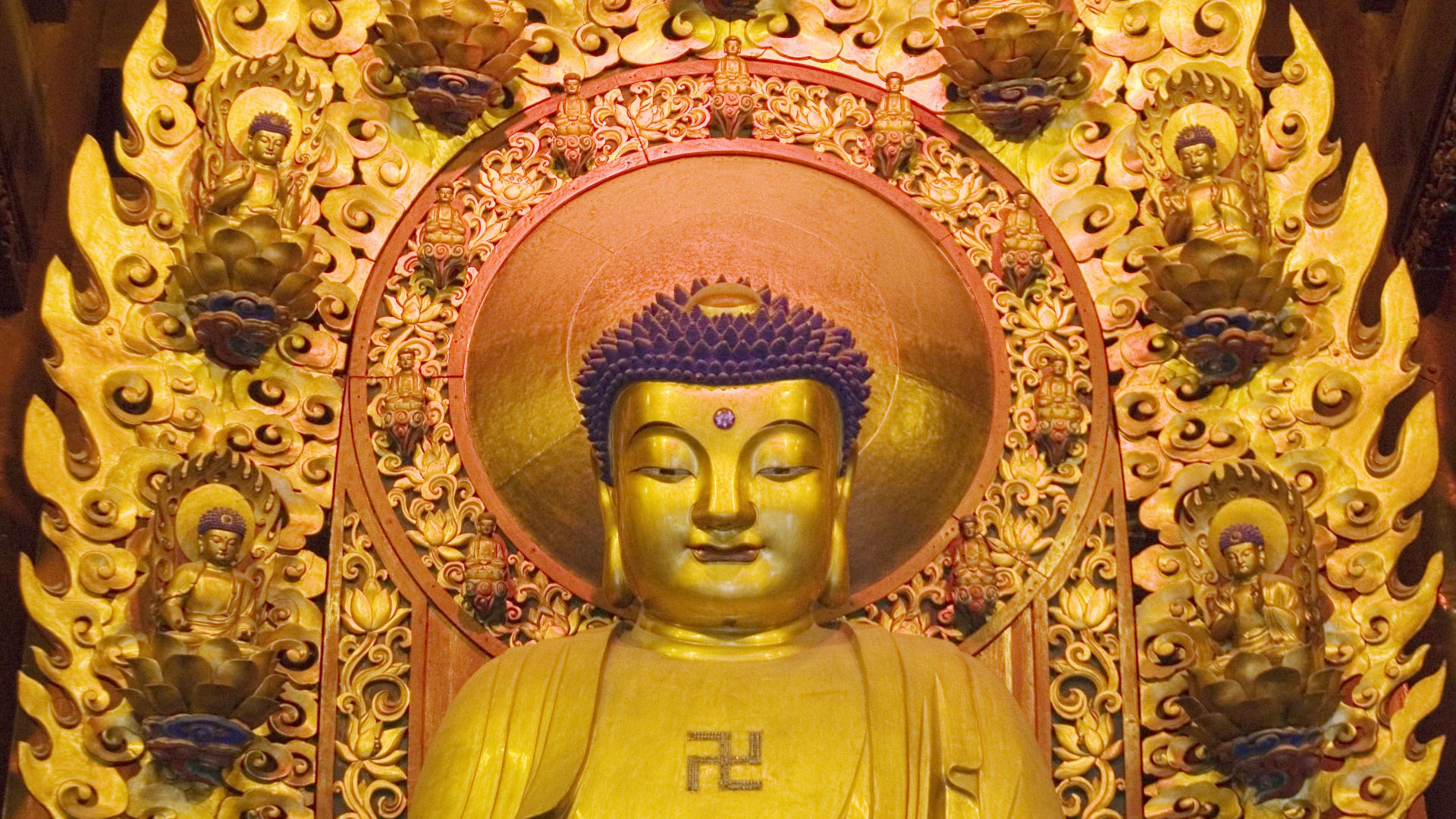 Gold Buddha figures at Longhua Temple, the oldest temple in Shanghai. (Credit: In Pictures Ltd./Corbis via Getty Images)