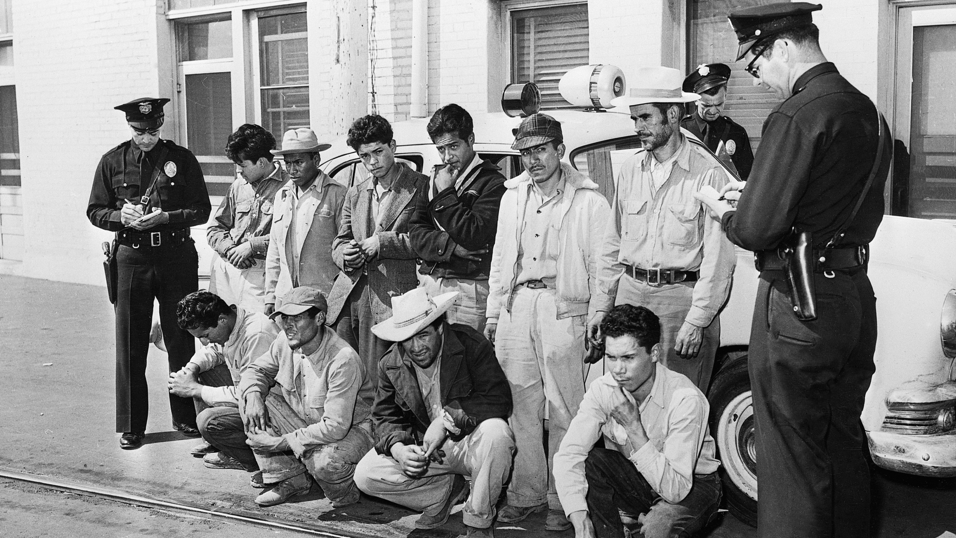 A group of Mexicans who were taken off freight trains in Los Angeles, after two days without food or water, in 1953. (Credit: Getty Images)