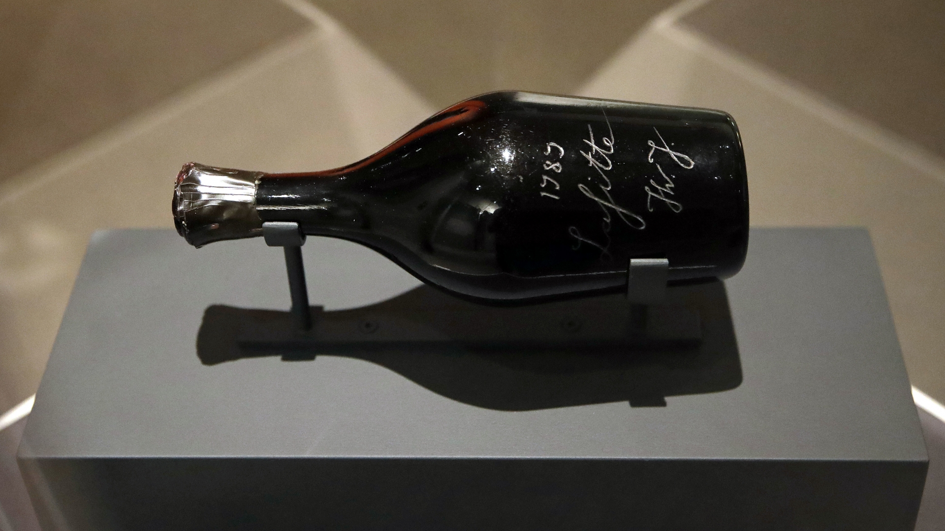 "A bottle of wine claimed to have belonged to Thomas Jefferson on display for ""Treasures on Trial: The Art and Science of Detecting Fakes"" at the Winterthur Museum in Wilmington, Delaware. (Credit: Patrick Semansky/AP Photo)"