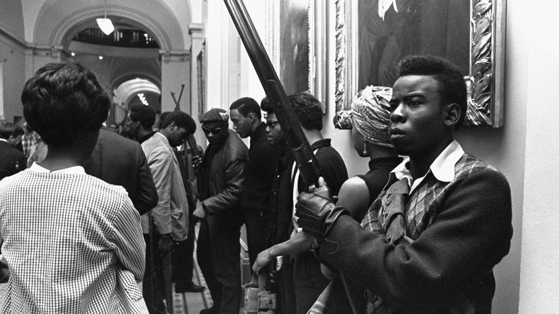 Armed members of the Black Panther Party standing in the corridor of the Capitol in Sacramento protesting a bill that restricted the carrying of arms in public, 1967. (Credit: Walt Zeboski/AP Photo)