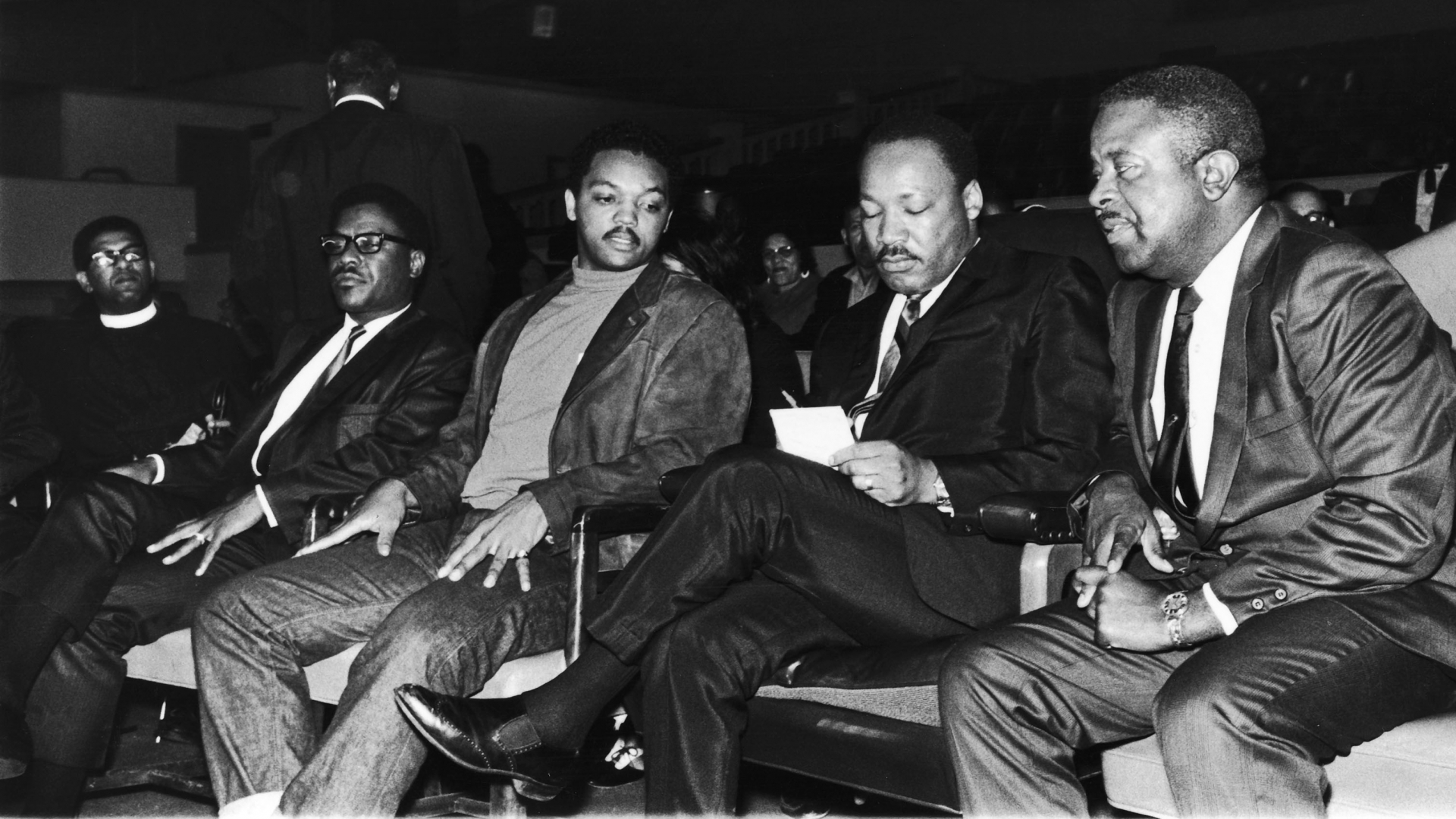 Jesse Jackson sitting on Martin Luther King, Jr.'s right-hand side, while looking over notes before King's famous 'Mountaintop' speech, which would be his last. (Credit: Maurice Sorrell/Ebony Collection via AP Images)
