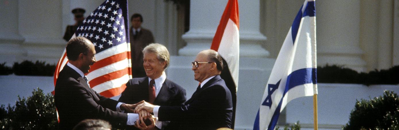 Anouar El Sadate, Jimmy Carter and Menahem Begin at the signature of Accords of Camp David in Washington on March 26, 1979. (Credit: Benami Neumann/Gamma-Rapho via Getty Images)