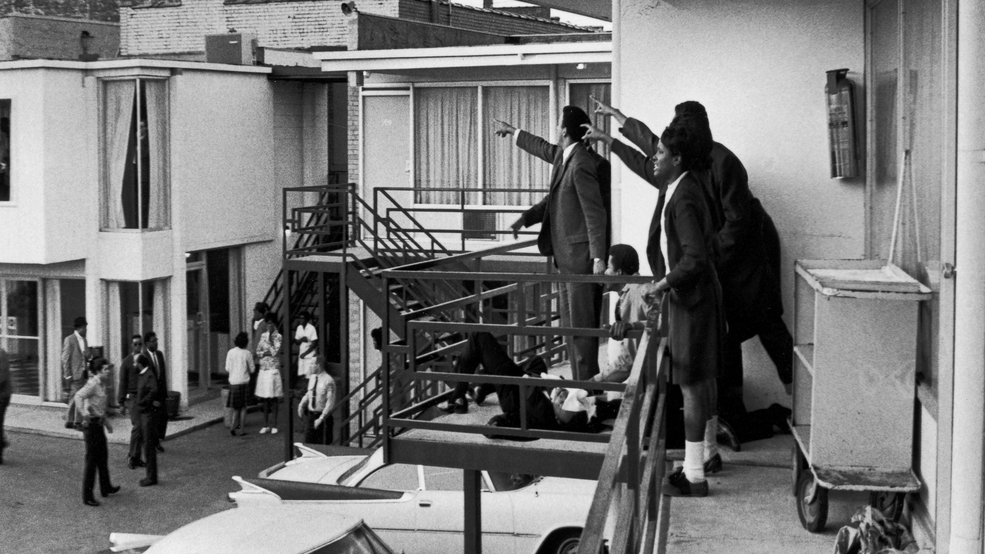 Dr. Ralph Abernathy, Jesse Jackson and others standing on the balcony of Lorraine Motel and point in the direction of gun shots that killed American civil rights leader Dr. Martin Luther King, Jr., who lies at their feet. (Credit: Joseph Louw/The LIFE Images Collection/Getty Images)