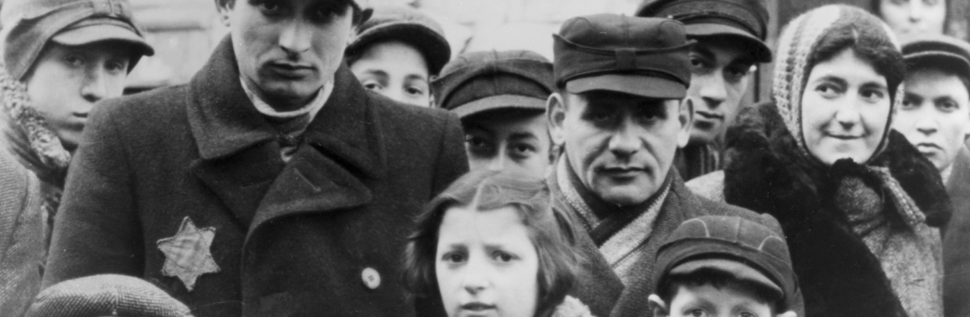Jews wearing Star of David badges in the Lodz Ghetto of Poland. Nazis forced Jews into over-crowded ghettos from which thousands were deported to the death camps. (Credit: Jewish Chronicle/Heritage Images/Getty Images)