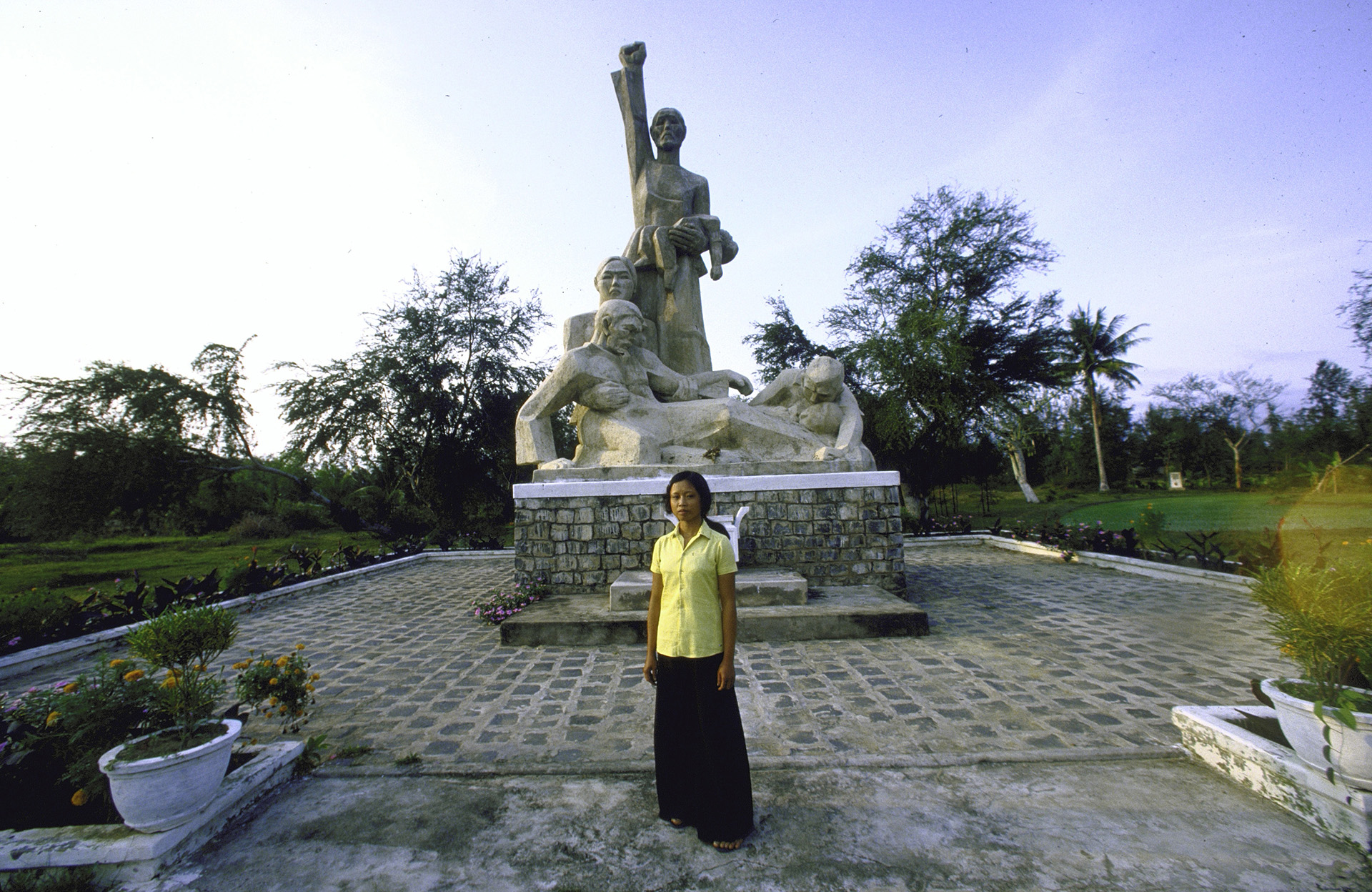 Pham Thi Trinh, one of the few survivors of My Lai Massacre, standing in front of monument honoring victims. (Credit: Dirck Halstead/The LIFE Images Collection/Getty Images)