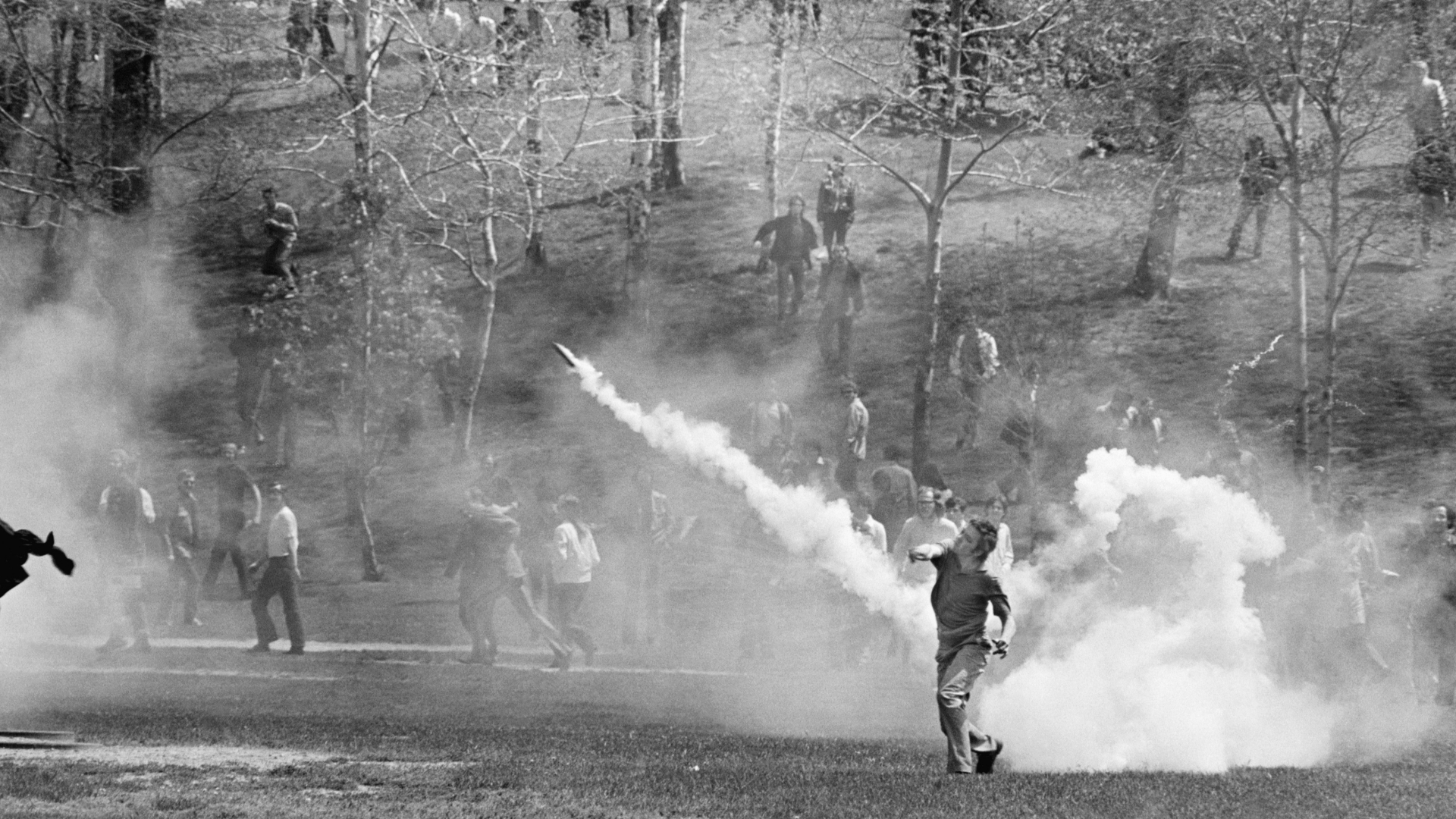 Kent State University student hurling a tear gas cannister back towards National Guardsmen as the military is called out May 4th to put down massive anti-war protest. (Credit: Bettmann Archive/Getty Images)