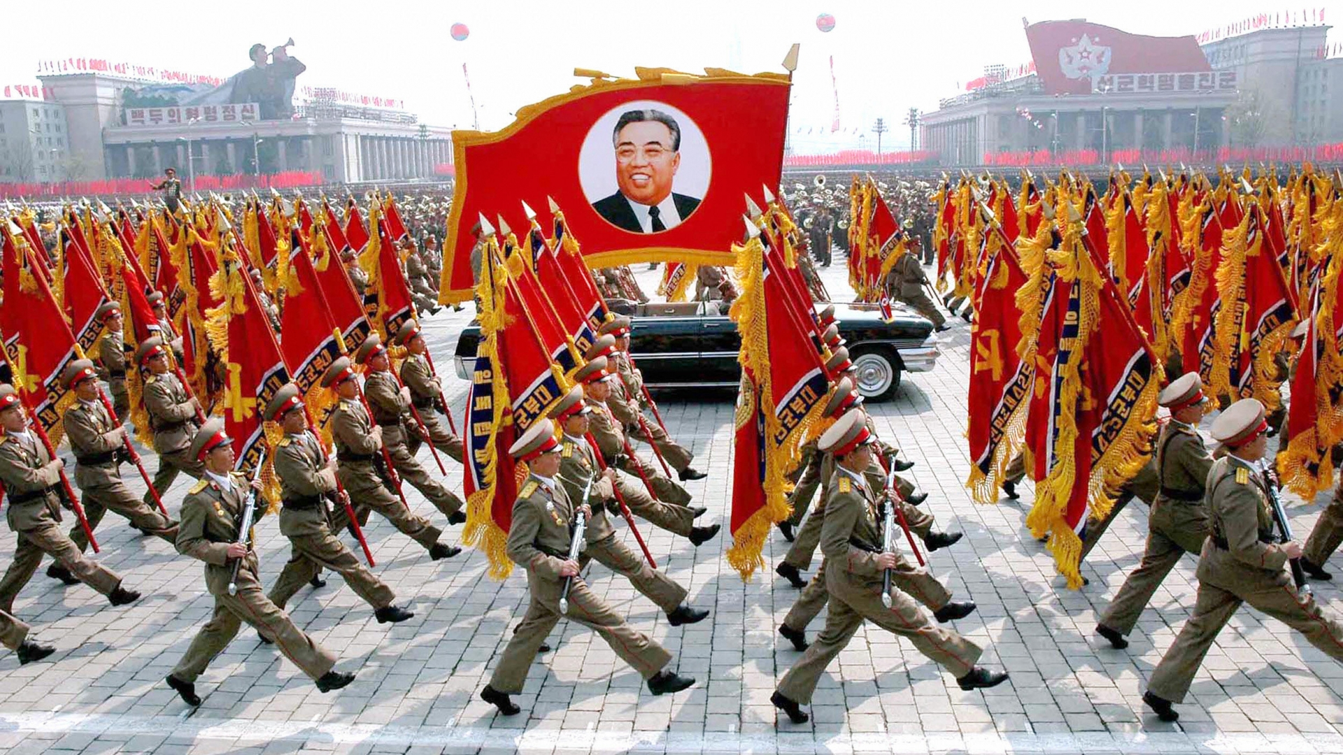 This picture, released from Korean Central News Agency in 2007, shows North Korean soldiers, carrying a large portrait of late North Korean leader Kim Il Sung during a military parade to celebrate the 75th founding anniversary of the KPA at the Kim Il Sung square in Pyongyang, North Korea. (Credit: KCNA/AFP/Getty Images)