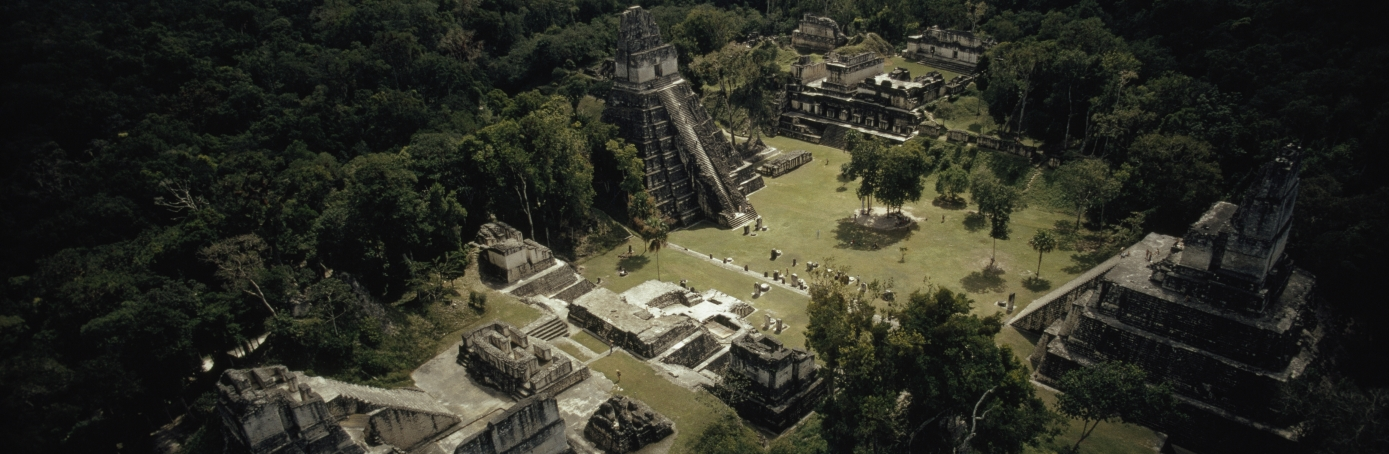 The temples at Tikal surround the Great Plaza, in Tikal National Park, Guatemala. (Credit: Wilbur E. Garrett/National Geographic/Getty Images)