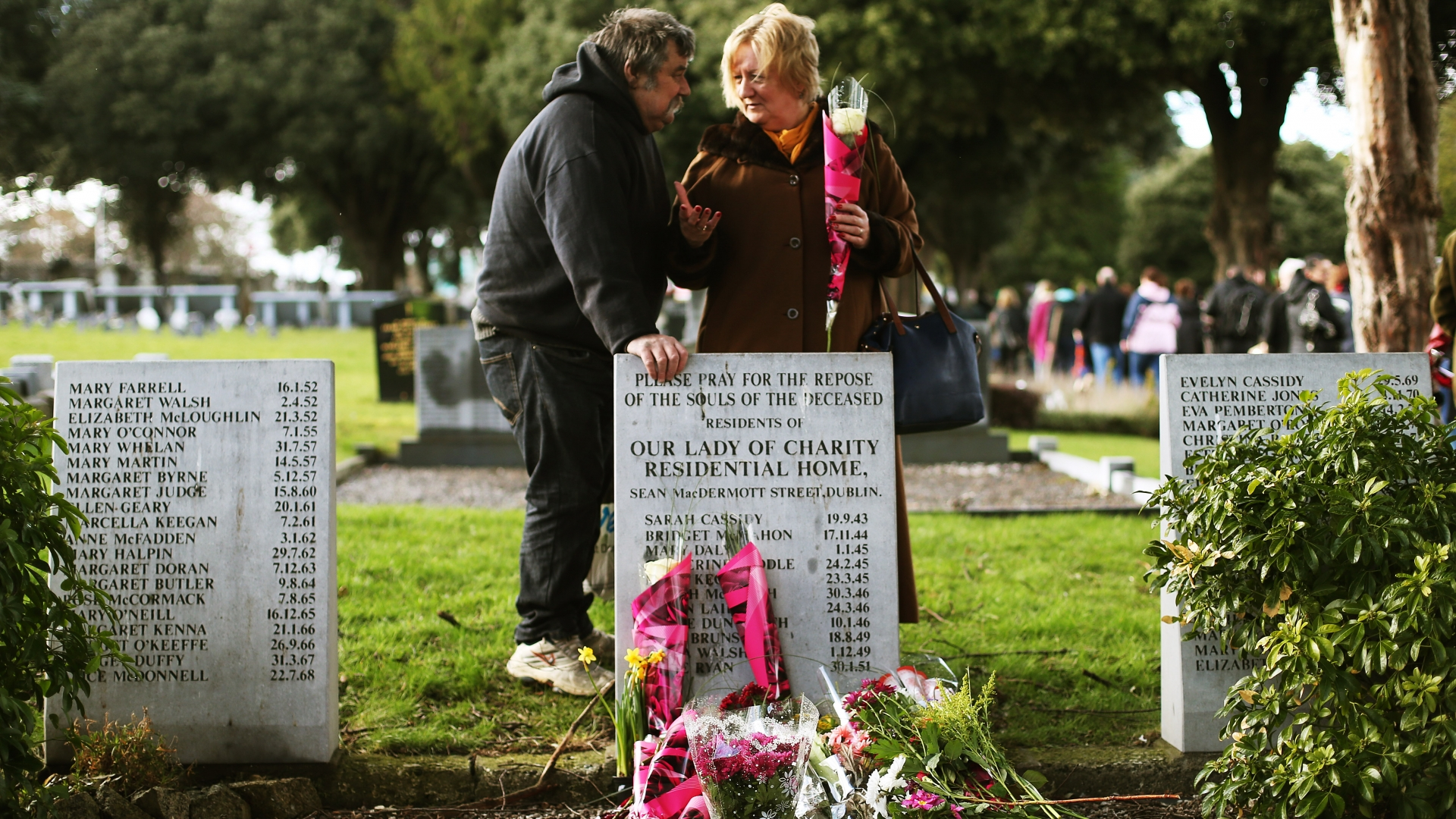 Kevin Flanagan with Marie Barry, who was born at a Bessboro Mother and Baby home, at the 2014 third annual Flowers for Magdalenes remembrance event in Glasnevin cemetery, Dublin, to mark all of the women incarcerated in the Magdalene laundries. (Credit: Brian Lawless/PA Images/Getty Images)