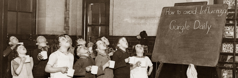 Schoolchildren gargling as a precaution against the Influenza epidemic, circa 1935. (Credit: Imagno/Getty Images)