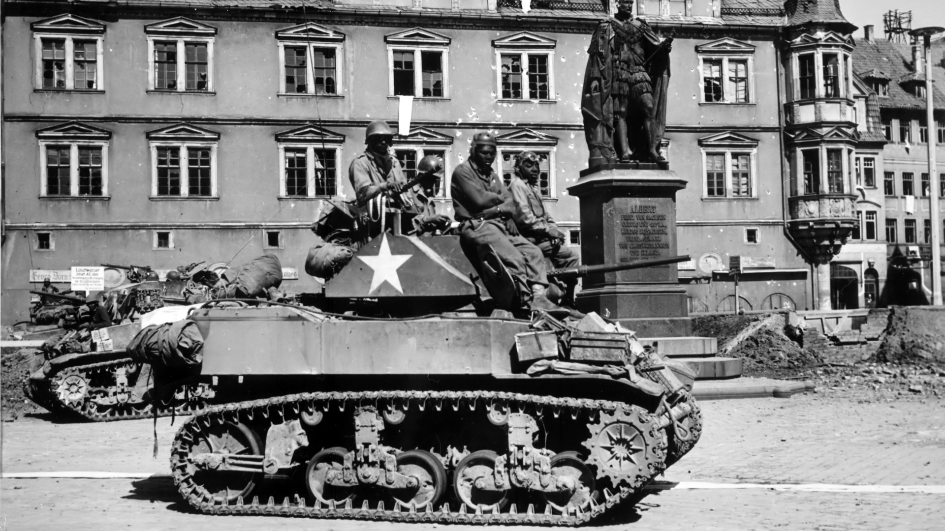 A tank and crew from the 761st Tank Battalion in front of the Prince Albert Memorial in Coburg, Germany, 1945. (Credit: The National Archives)