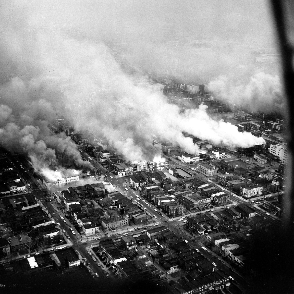 An aerial view of clouds of smoke rising from burning buildings in northeast Washington, D.C. on April 5, 1968. (Credit: AP Photo)