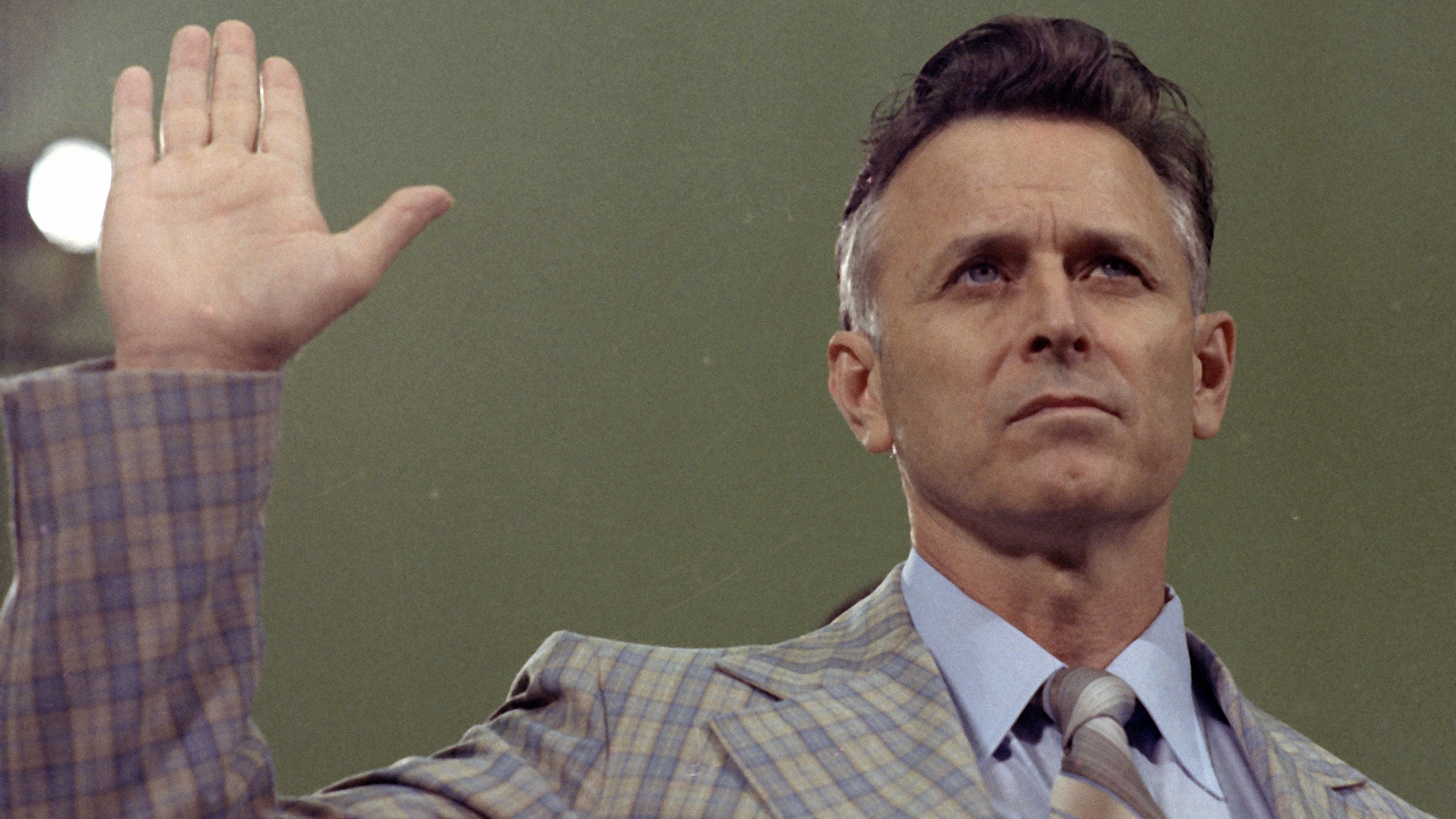 James Earl Ray, convicted killer of civil rights leader Dr. Martin Luther King Jr., shown on August 16, 1978, being sworn in prior to testifying before the House Select Committee on Assassinations in Washington. (Credit: AP Photo)