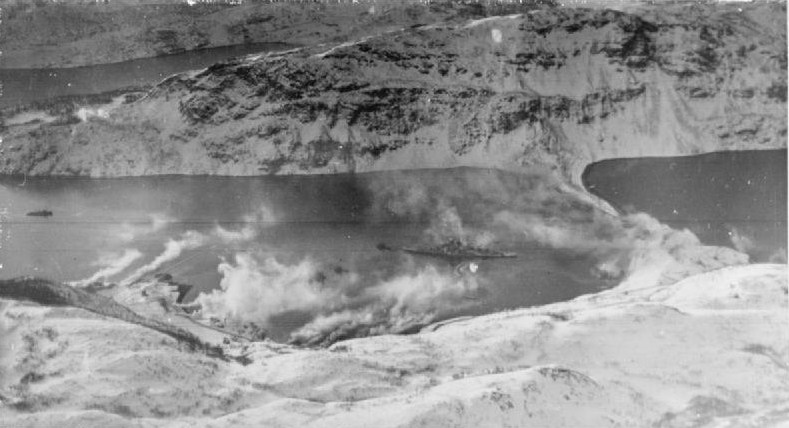 Smoke screens put up in attempts to hide the Tirpitz battleship drifting in the waters. (Credit: Imperial War Museum)