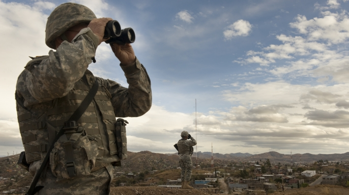 Members of the US Army National Guard keep watch along the US Mexico border in Nogales, Arizona, 2010. (Credit: Nikki Kahn/The Washington Post via Getty Images)