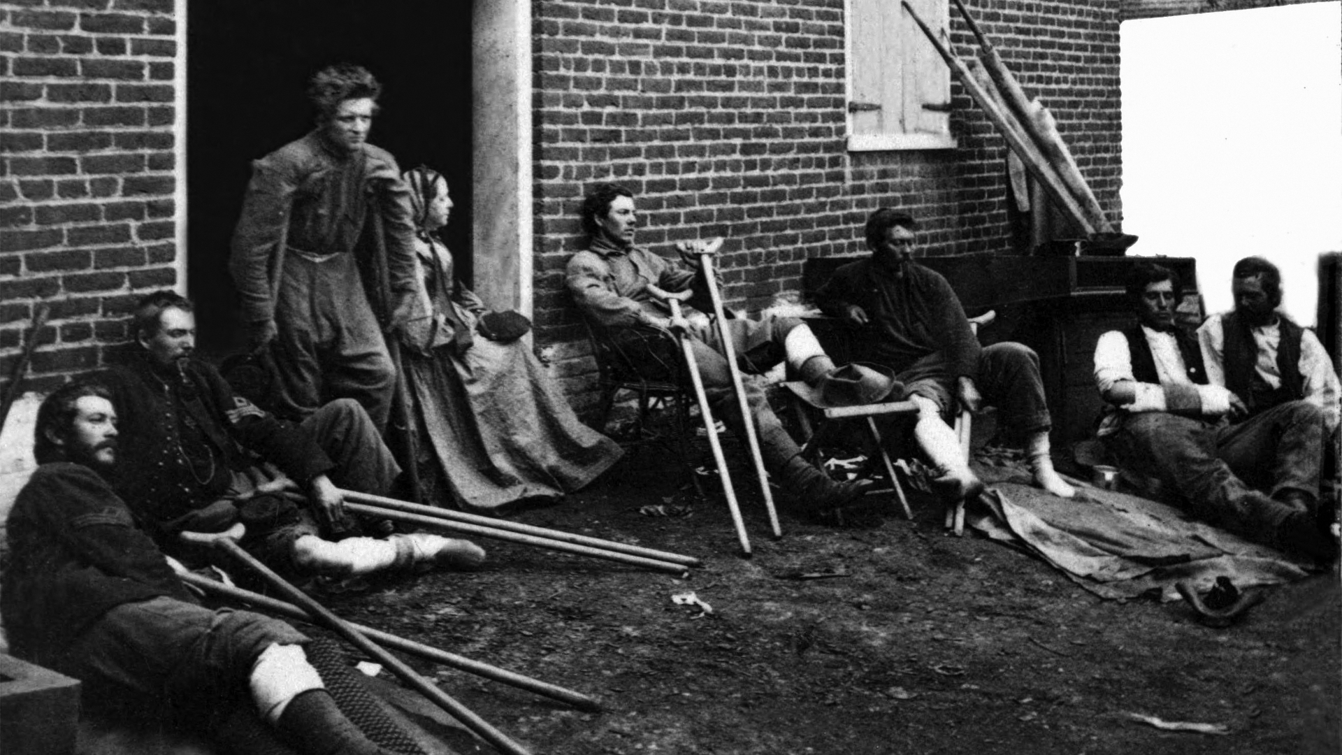 Wounded soldiers outside a brick hospital building in Fredericksburg, Virginia, 1864. (Credit: James Gardner/Buyenlarge/Getty Images)