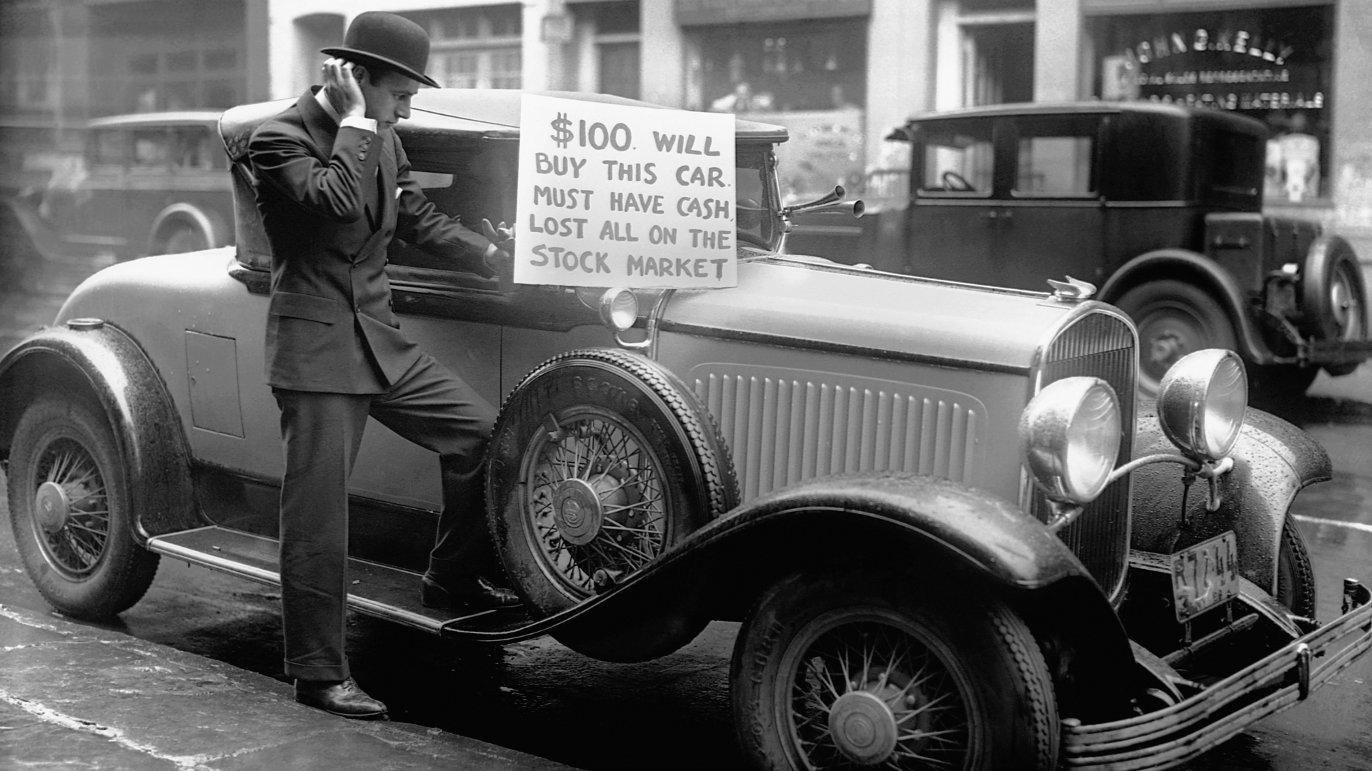 Bankrupt investor Walter Thornton trying to sell his luxury roadster for $100 cash on the streets of New York City following the 1929 stock market crash. (Credit: Bettmann Archive/Getty Images)