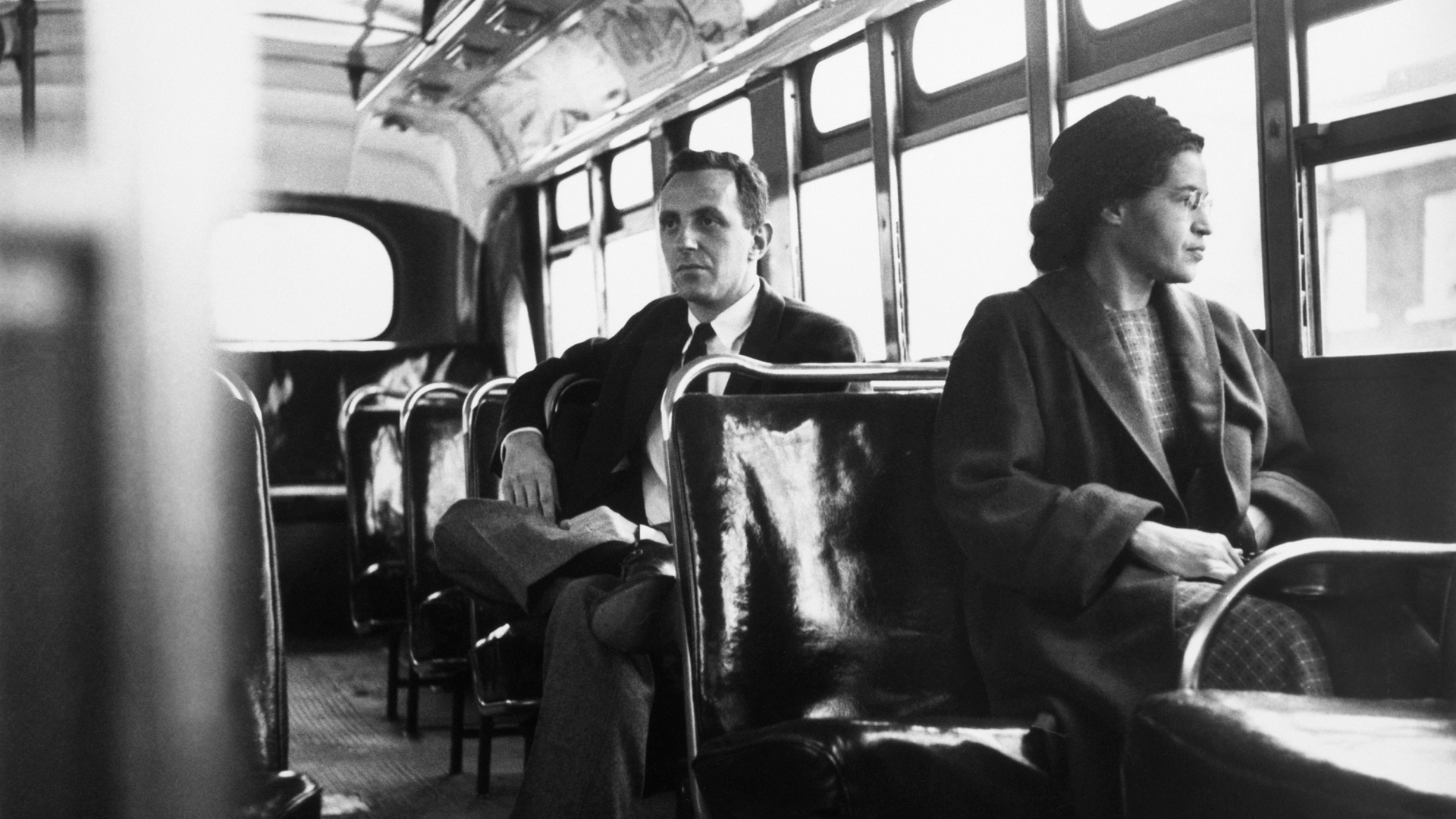 Rosa Parks sitting in the front of a bus in Montgomery, Alabama, after the Supreme Court ruled segregation illegal on the city bus system on December 21st, 1956. (Credit: Bettmann Archive/Getty Images)