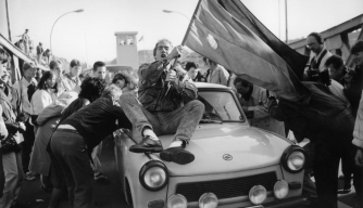 An excited crowd crossing the border at the Bornholm Bridge after the fall of the Berlin Wall.  (Credit: Brigitte Hiss/ullstein bild via Getty Images)