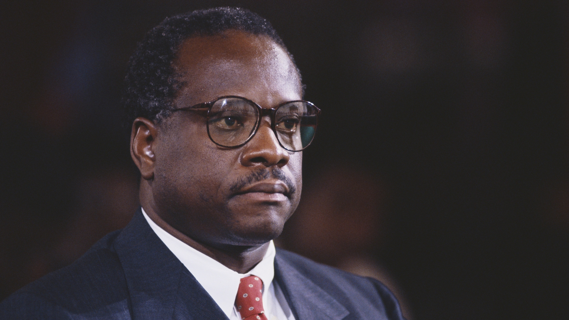 Clarence Thomas awaits proceedings during his hearing regarding the alleged sexual harassment of Anita Hill. (Credit: Wally McNamee/Corbis/Getty Images)