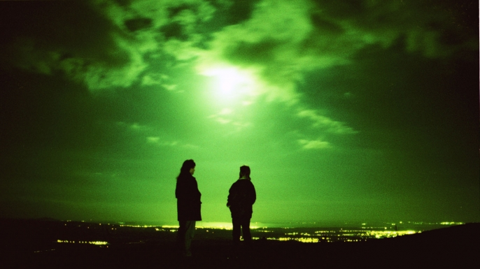 UFO spotters looking out over the Forth Valley in central Scotland where unexplained sightings are said to be frequent. (Credit: Colin McPherson/Sygma/Getty Images)