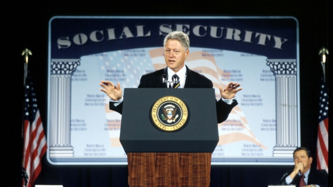 President Bill Clinton addressing a White House conference to discuss ideas about how best to reform Social Security to ensure its solvency well into the 21st century, 1998. (Credit: Robert Giroux/Getty Images)