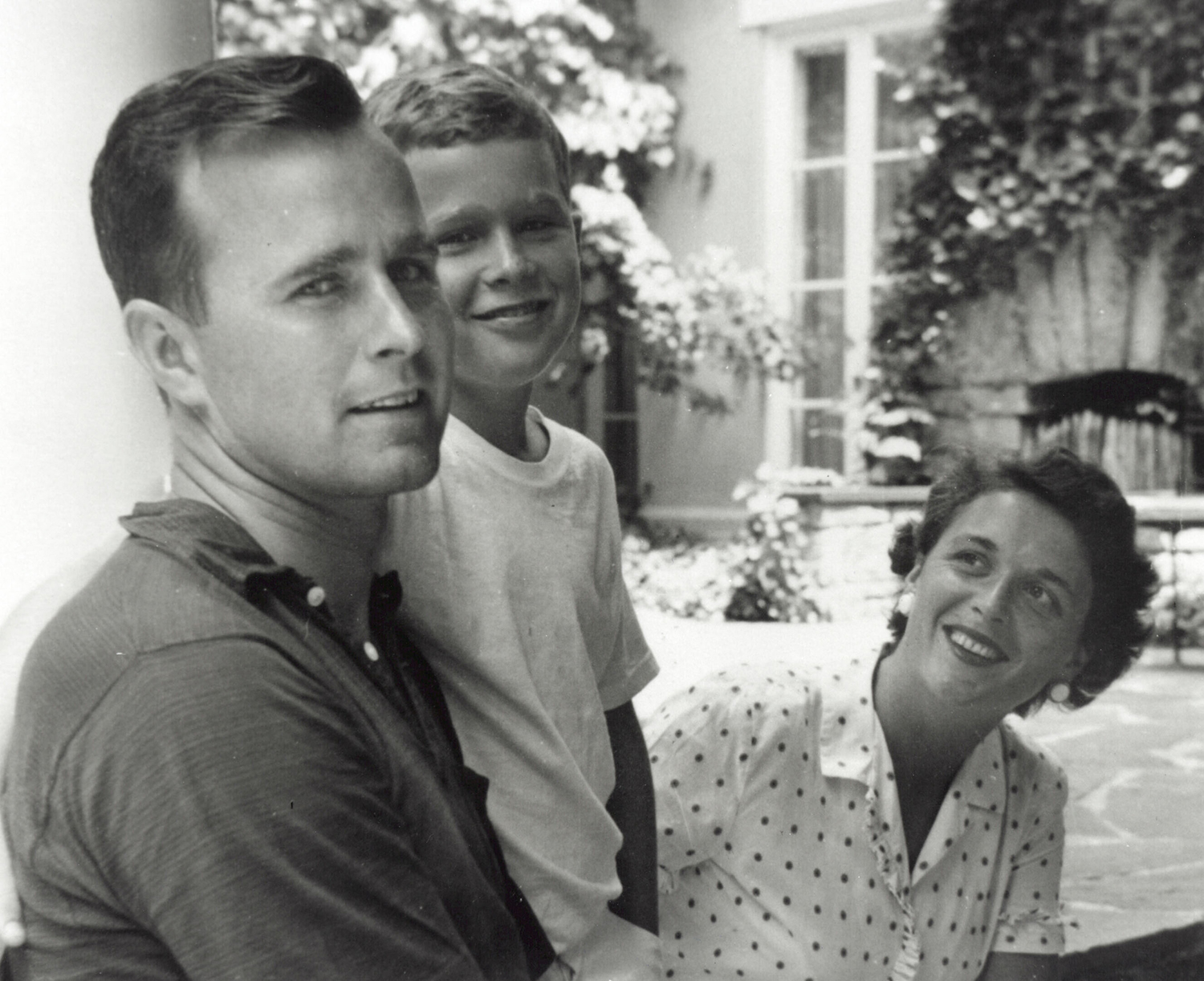 Barbara Bush with her son George W. Bush and husband George Bush in Rye, New York, 1955. (Credit: Newsmakers/Getty Images)