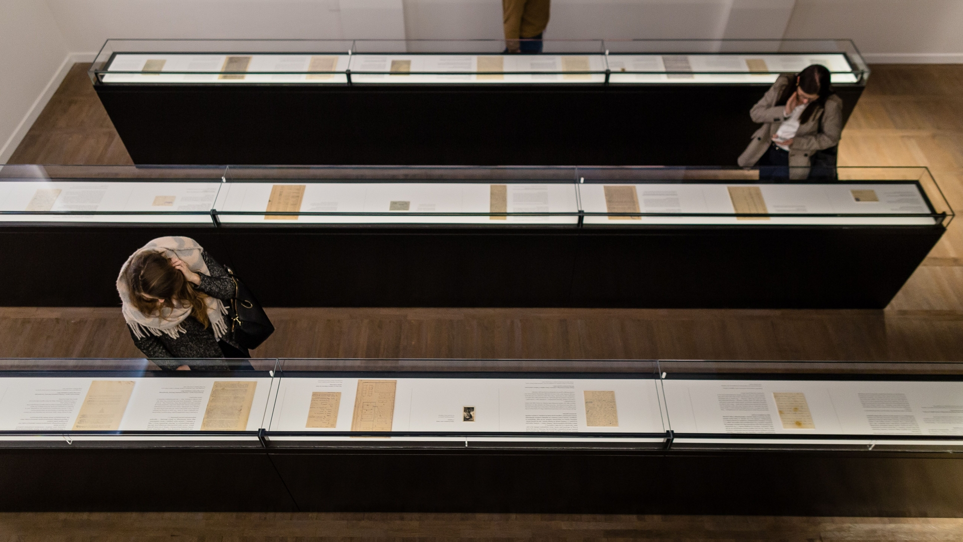 People visitng the Jewish Historical Institute in Warsaw, which includes a permanent exhibition titled 'What We Were Unable To Shout Out To The World' featuring the Ringelblum Archive. (Credit: Wojtek Radwanski/AFP/Getty Images)