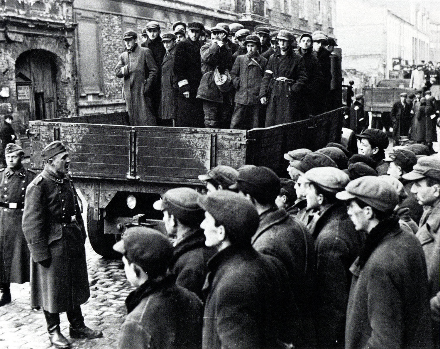 Jewish men being transported for labor from the Warsaw Ghetto, 1941. (Credit: Galerie Bilderwelt/Getty Images)