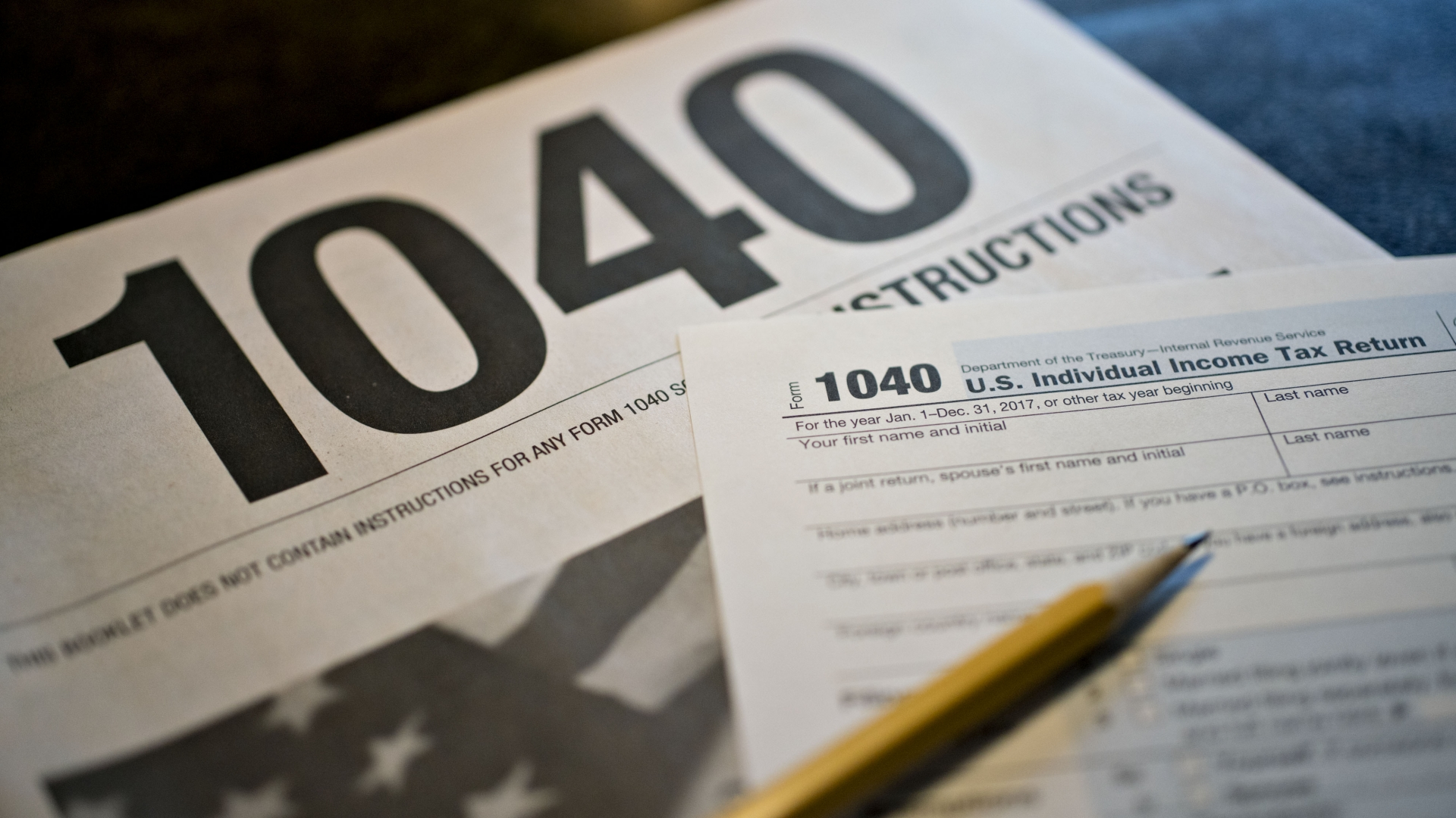 U.S. Department of the Treasury Internal Revenue Service (IRS) 1040 Individual Income Tax forms for the 2017 tax year. (Credit: Daniel Acker/Bloomberg via Getty Images)
