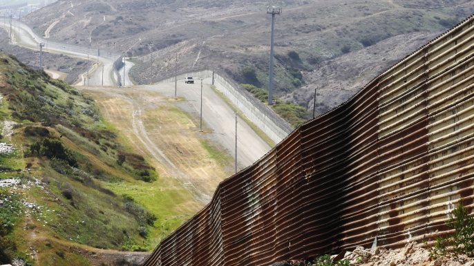 A wall and fencing that run along the U.S.-Mexico border in Tijuana, Mexico, 2018.  (Credit: Mario Tama/Getty Images)