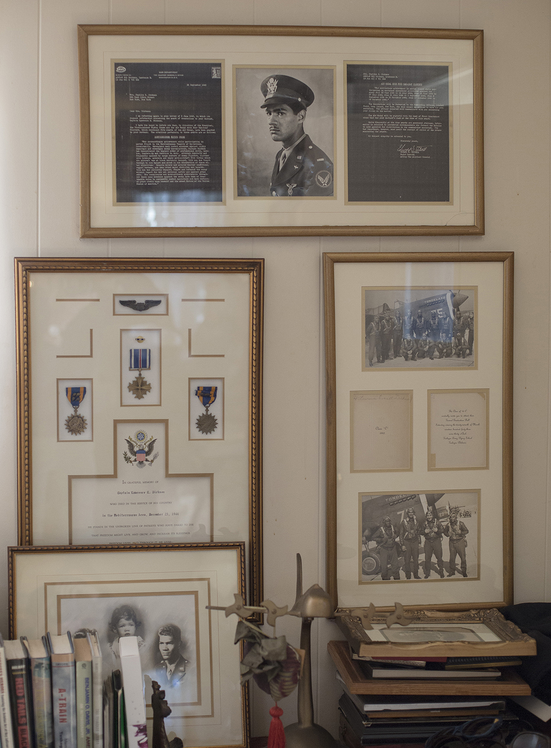 Photographs and medals belonging to Tuskegee Airman Capt. Lawrence E. Dickson, hanging in his daughters home. (Credit: Bryan Anselm/The Washington Post via Getty Images)