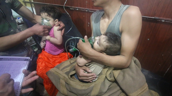 Syrian children receiving medical treatment after a poisonous gas attack in Eastern Ghouta, Damascus, April 7, 2018. (Credit: Halil el-Abdullah/Anadolu Agency/Getty Images)